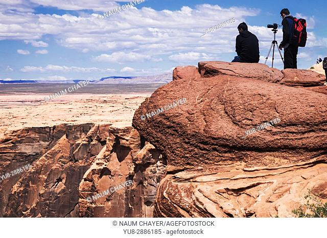 Two photographers near Horseshoe Bend, Glen Canyon National Recreation Area,. Arizona, USA