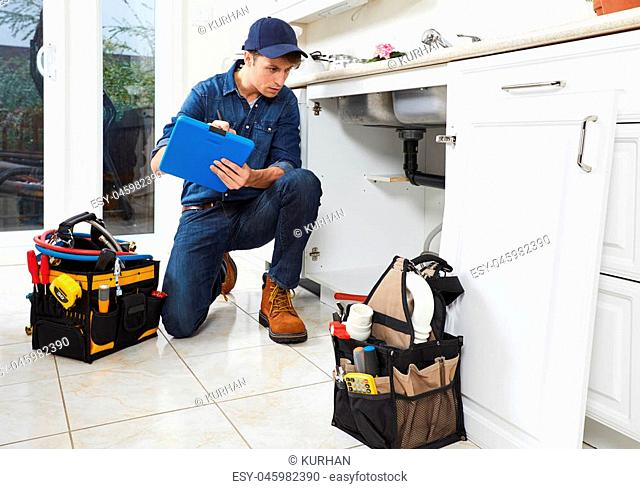 Professional plumber doing renovation in kitchen home