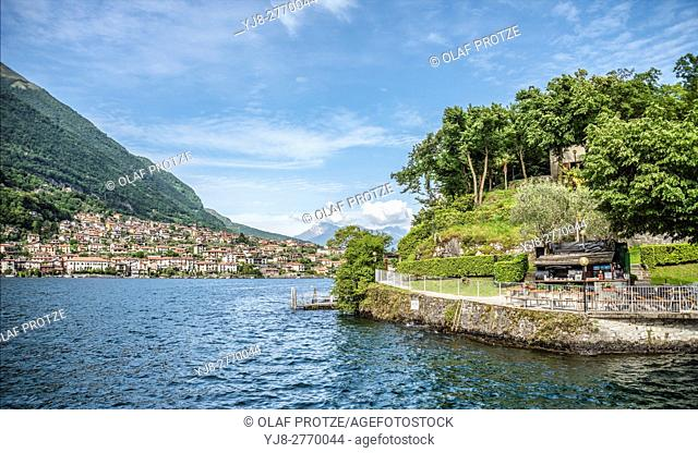 Shipping Pier of Isola Comacina at Lake Como seen from the lakeside, with Ossuccio in the background, Lombardy, Italy