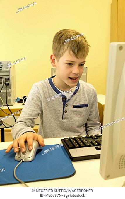 Elementary school student working in computer room, Lower Saxony, Germany