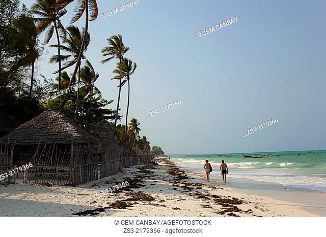 Tourists walking on the beach, Paje, Zanzibar Island, Zanzibar Archipelago,Tanzania, East Africa