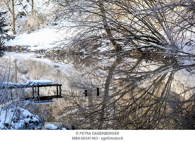 A winter landscape in Bavaria - snow, ice and frost control the nature
