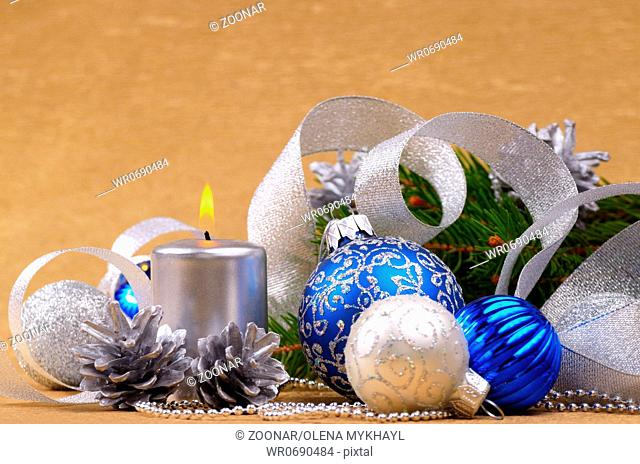 Blue and white christmas balls with silver candle