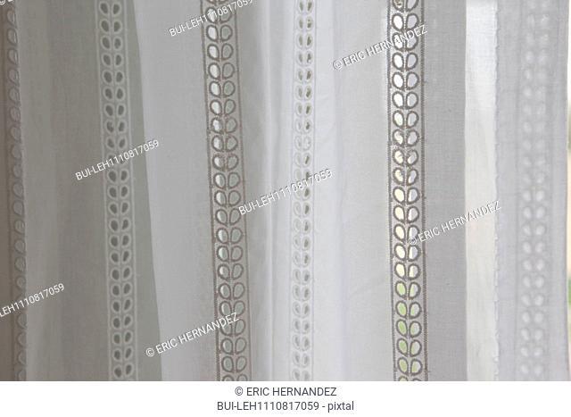 Detail shot of a white curtain