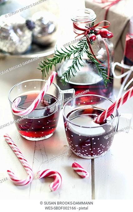 Glasses of mulled wine, candy canes and Christmas decoration