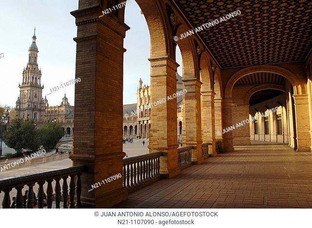 Arched galleries and one of the two main towers of a neo-renaissance palace in the shape of a semi-circular theatre. Plaza de España