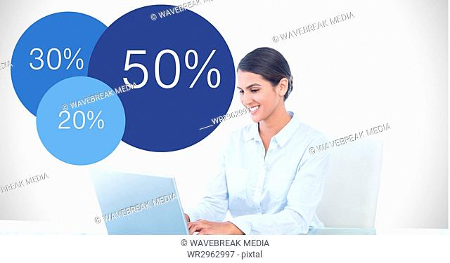 Businesswoman using laptop by data