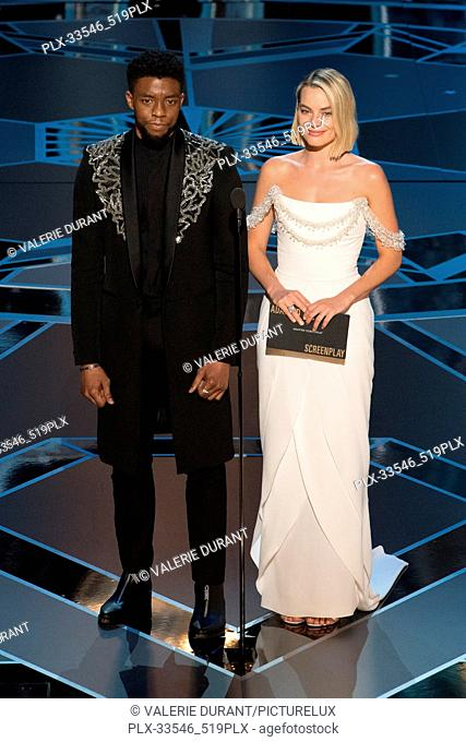 Chadwick Boseman and Margot Robbie present the Oscar® for best adapted screenplay during the live ABC Telecast of The 90th Oscars® at the Dolby® Theatre in...
