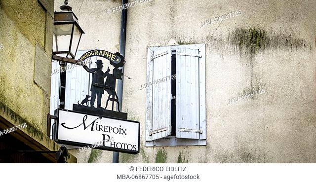 Photographers' advertising sign made of iron at Mirepoix