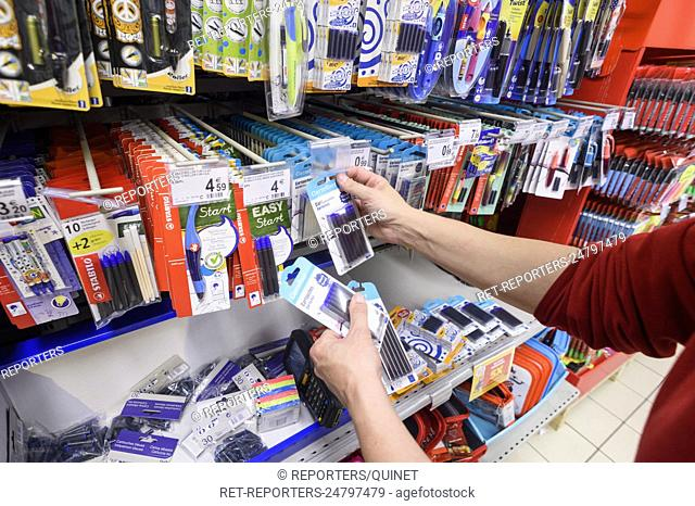 The back-to-school supply are stored on the shelves in the shops to meet the demand of the customers, the family and the pupils