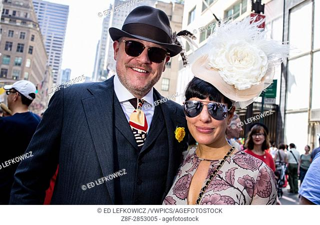 New York, NY - April 16, 2017. A nattily dressed man and woman New York's annual Easter Bonnet Parade and Festival on Fifth Avenue
