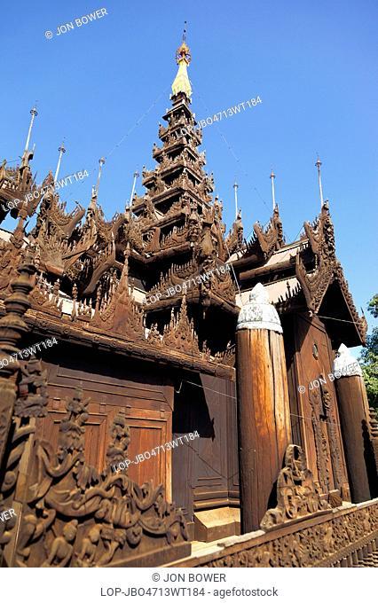 Myanmar, Mandalay, Mandalay. The intricately carved teak monastery at Shwe Inbin in Mandalay in Myanmar