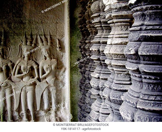 Balustrade columns and dancing figures at Angkor Wat temple in Cambodia