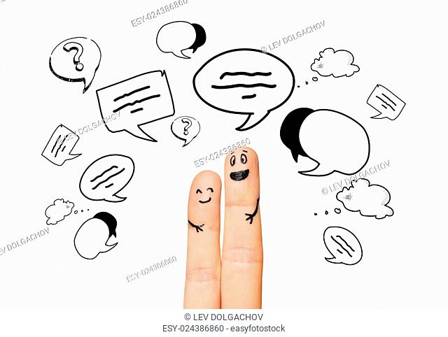 communication, family, couple, people and body parts concept - close up of two fingers with different facial expressions and text clouds