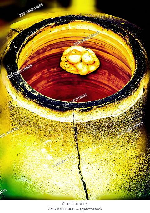 A Naan (flat, unleavened bread) begins to bubble in a Tandoor. Naan is the staple throughout the middle east and beyond, typically served with Kebabs and...
