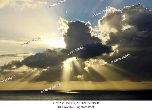 Sunbeams bursting through cloud at sunset over the Bristol Channel near Ilfracombe, Devon, England, United Kingdom