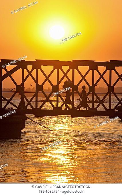 Bridge and pedestrian at sunset