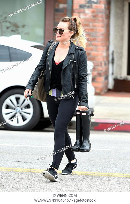 Hilary Duff carries a pair of Hunter rain boots as she leaves the gym Featuring: Hilary Duff Where: Los Angeles, California