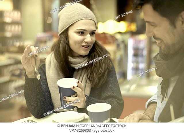 couple at coffee shop, in Munich, Germany