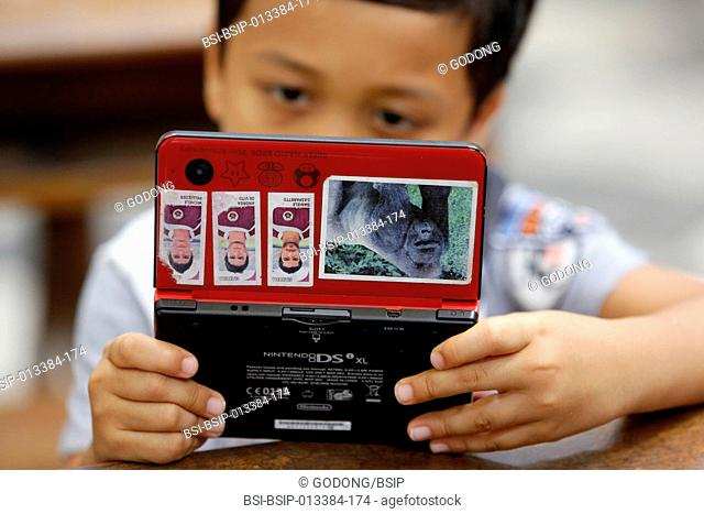 Boy playing with a games console