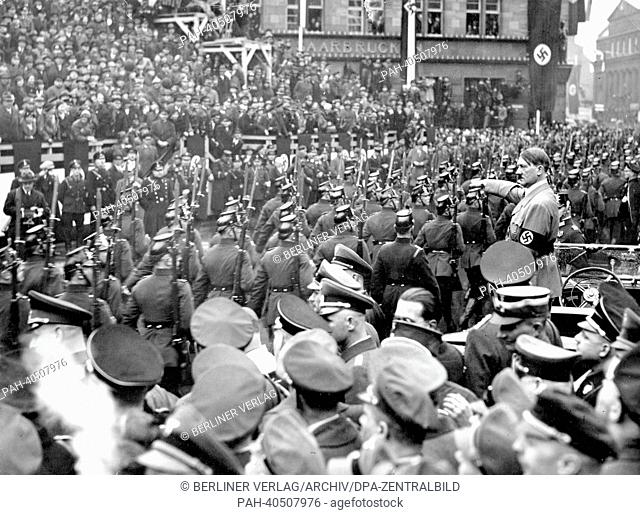 View of a parade for Adolf Hitler (m) on the occasion of the handover of the Saar territory to the German Reich by the League of Nations, in Saarbrücken