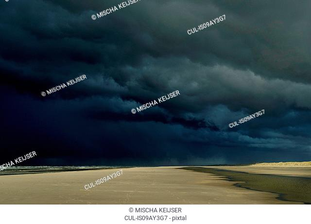 Hailstorm approaching the island of Terschelling from the North Sea, West aan Zee, Friesland, Netherlands