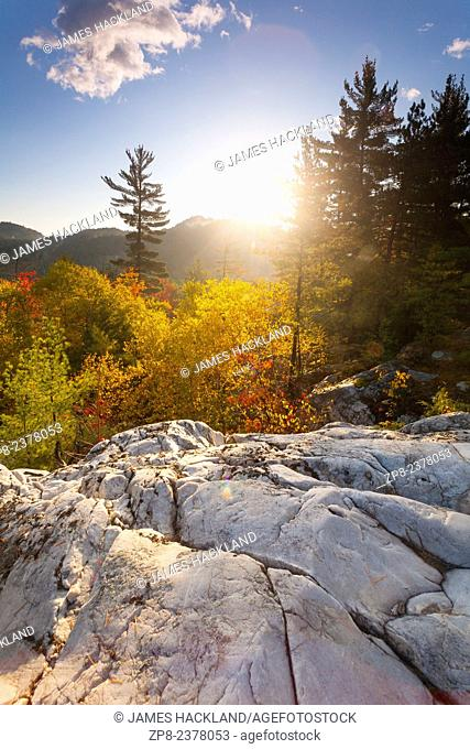 Surise with autumn colour and white quartzite rock in the foreground. Killarney Provincial Park. Ontario, Canada