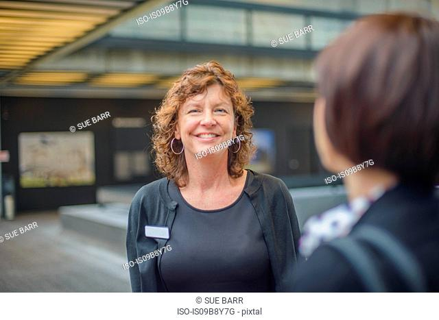 Woman with name tag smiling