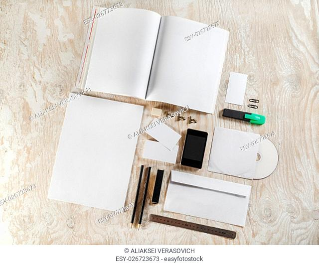 Blank stationery and corporate identity template on light wooden background. For design presentations and portfolios