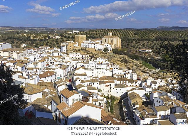 Setenil de las Bodegas, Cadiz Province, Spain. Commonly known simply as Setenil. Overall view. In the centre, remains of the castle built during the 12th and...