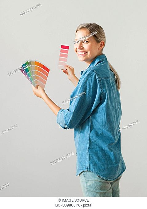 Young woman choosing paint color