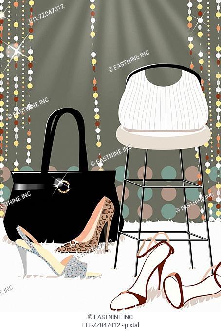 Close-up of high heels near a hand bag on a mat