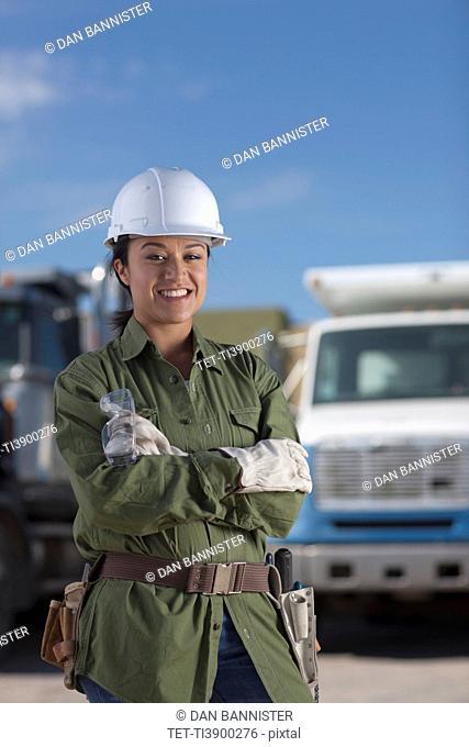 Portrait of female construction worker on building site