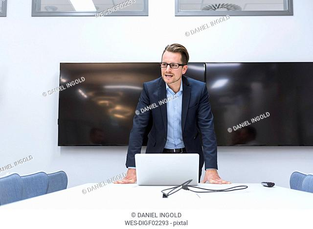 Manager giving a presentation in a conference room