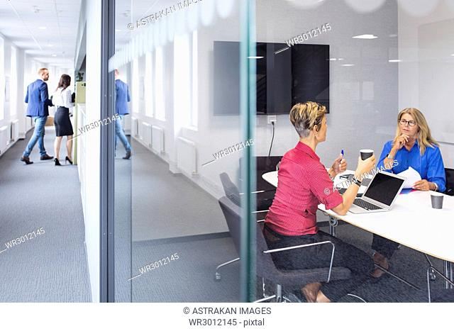 Architects working in office