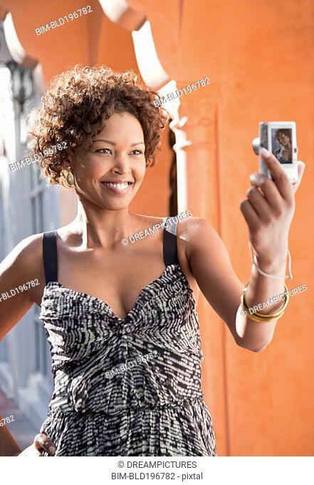 African American woman taking self-portrait