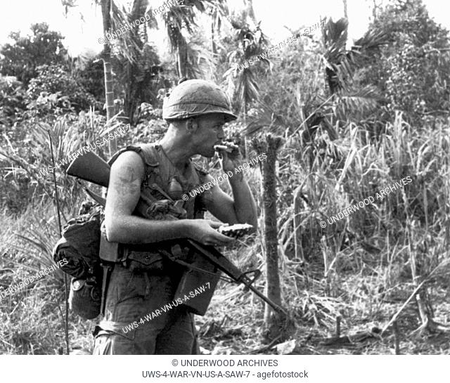 Boi Lo Woods, Vietnam: May, 1966 A 25th Infantry Division soldier takes a refreshing bite out of a freshly picked pineapple while on a search and destroy...