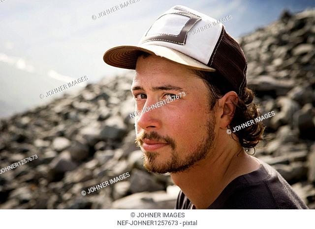 Man wearing cap looking at camera