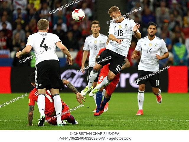 Germany's Joshua Kimmich (2nd from right) heads the ball during the Group B preliminary stage soccer match between Chile and Germany at the Confederations Cup...