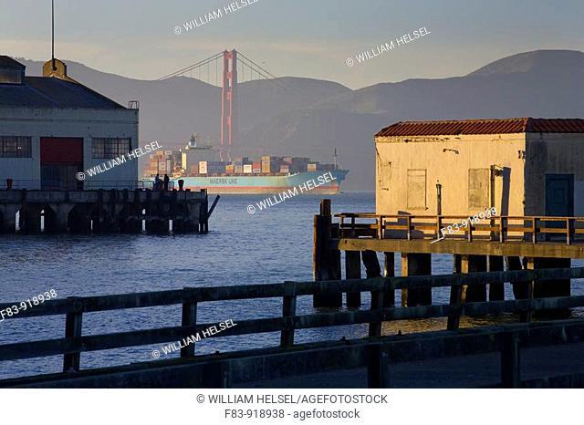 USA, California, San Francisco, piers at Fort Mason, fishermen, San Francisco Bay, container ship, Golden Gate Bridge, headlands of Marin County, late afternoon