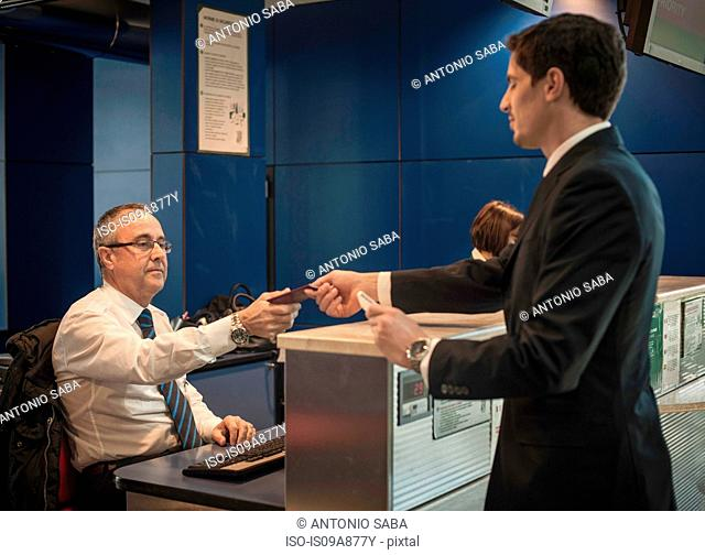 Businessman at airport check in area