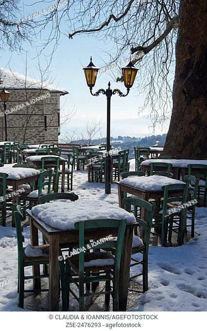 Snow covered tables and chairs of a taverna on Pelion Peninsula, Thessaly, Greece