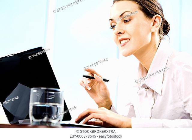 Portrait of responsible secretary doing some computer work