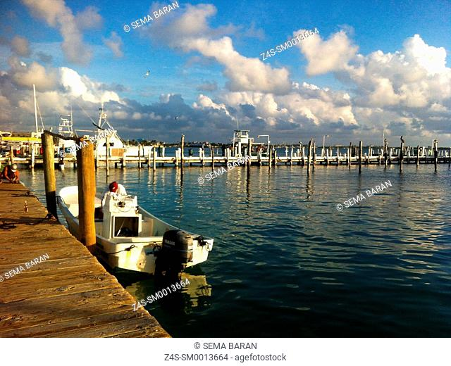Lonely fisher boat near the pier of Isla Mujeres, Cancun, Quintana Roo, Yucatan Province, Mexico, Central America