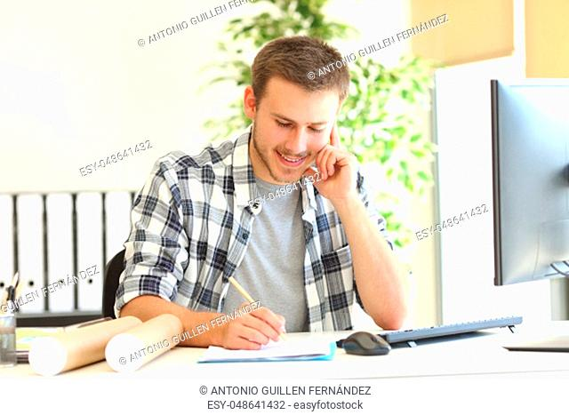 Designer or architect working writing notes at office