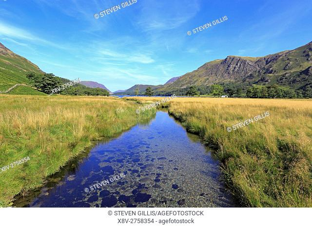 Warnscale Beck flowing into Buttermere Lake, Cumbria, Lake District National Park, England, UK
