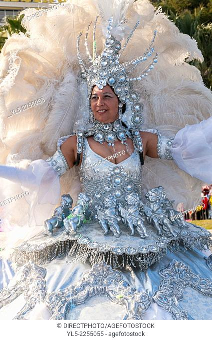 Nice, France, Woman in Costume Parading in Front of Crowd on Street at Traditional Spring Carnival parade