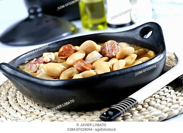 Butter beans with chorizo, bacon and pork ear