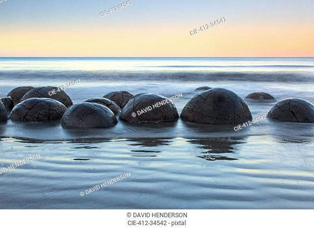Tranquil seascape and boulders, Moeraki Boulders, South Island, New Zealand
