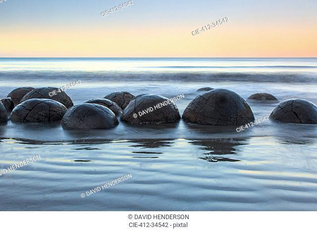 Tranquil seascape and boulders, Moeraki Boulders, South Island, New Zealand